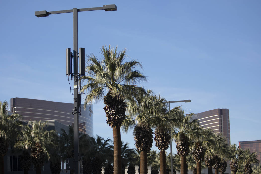 A small cell site is installed on a street light on Flamingo Road on Friday, Jan. 31, 2020, in ...