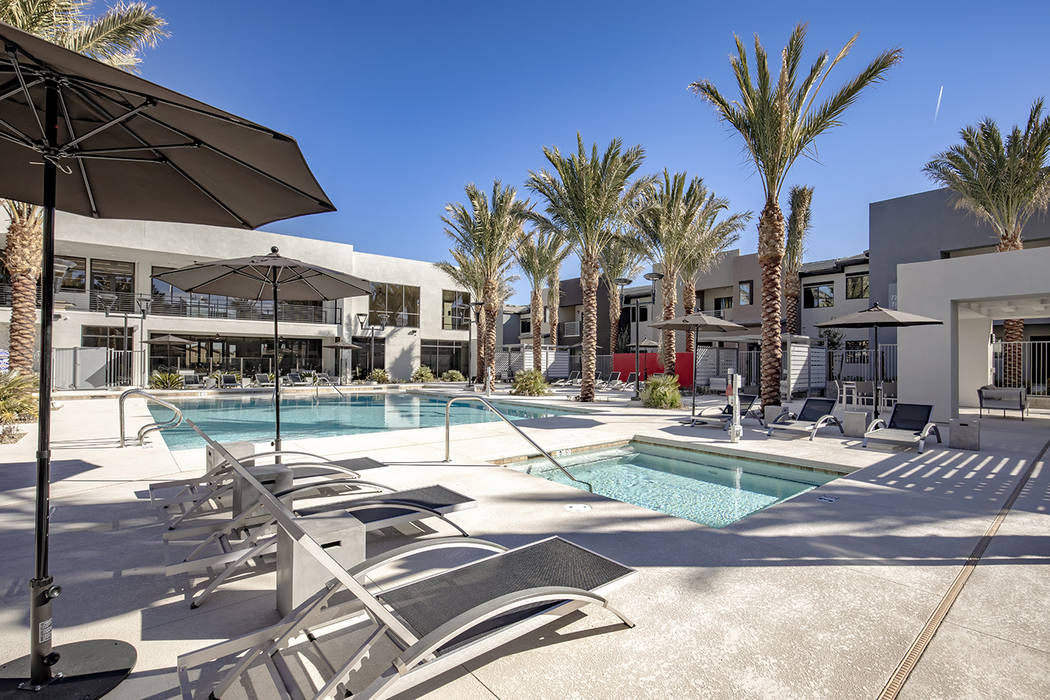 Luxury apartment complex offers a resort-style swimming pool. (Empire)
