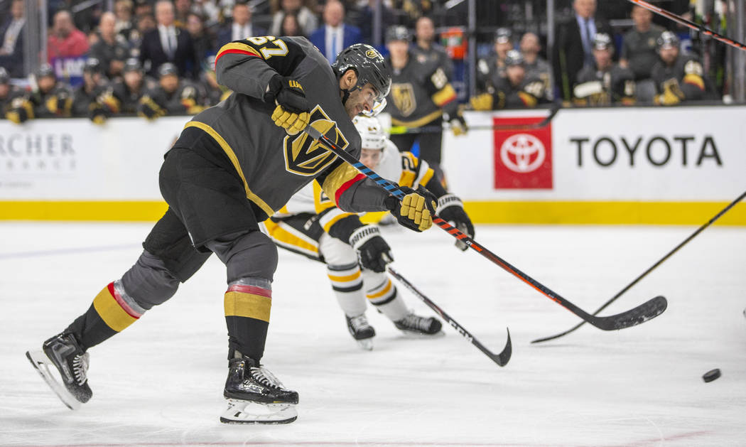 Vegas Golden Knights' Max Pacioretty (67) shoots against the Pittsburgh Penguins during the sec ...