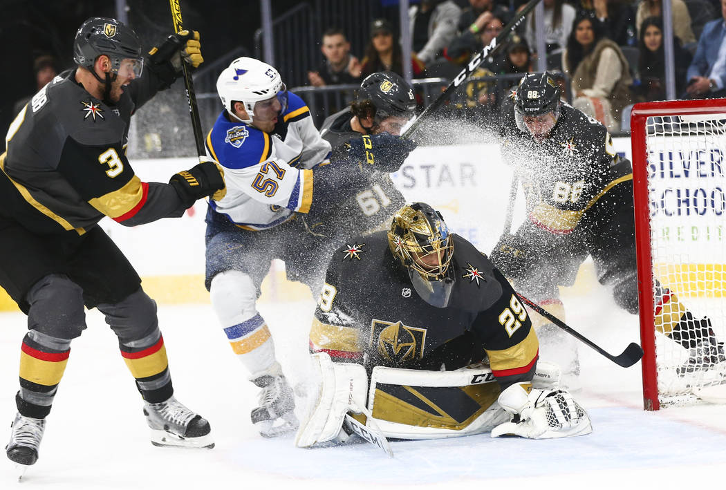 Golden Knights goaltender Marc-Andre Fleury (29) blocks the puck in front of St. Louis Blues' D ...