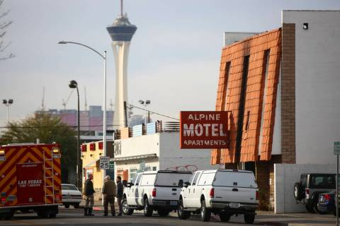 Las Vegas firefighters respond to the scene of a fire at the Alpine Apartment Motel in downtown ...