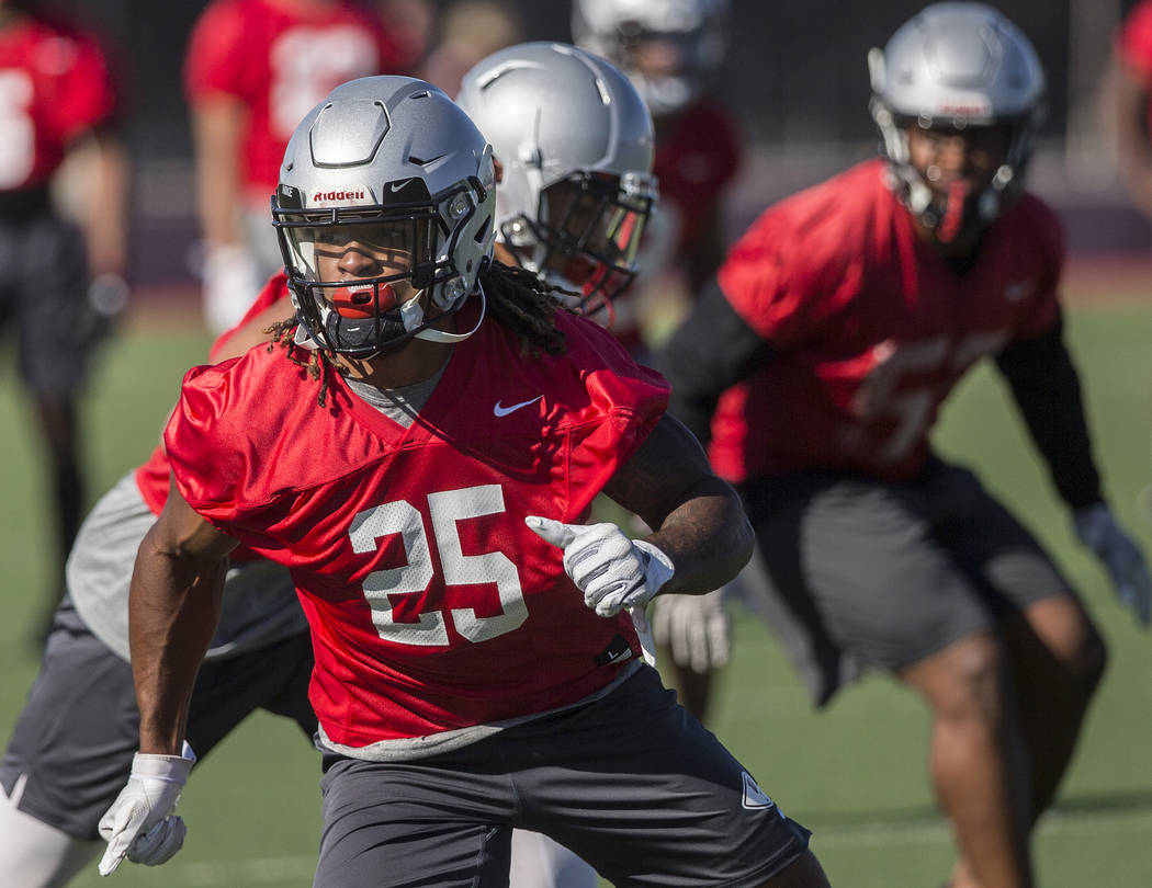 UNLV defensive end/linebacker Gabe McCoy (25) works through drills during the first day of trai ...