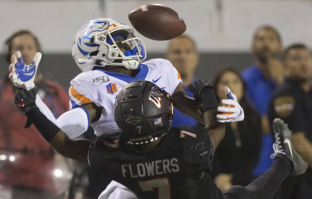 Boise State Broncos wide receiver John Hightower (16) fights for a deflected pass with UNLV Reb ...