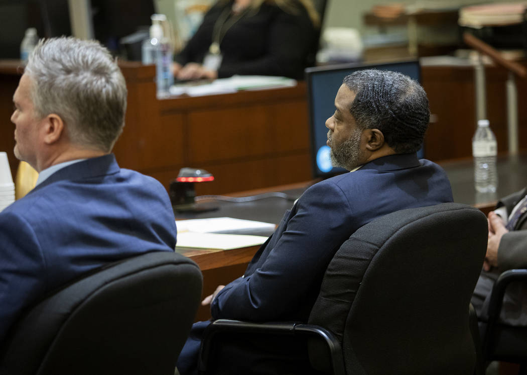 Charles Talley Jr., right, sits next to his defense attorney Michael Hyte, left, during his tri ...