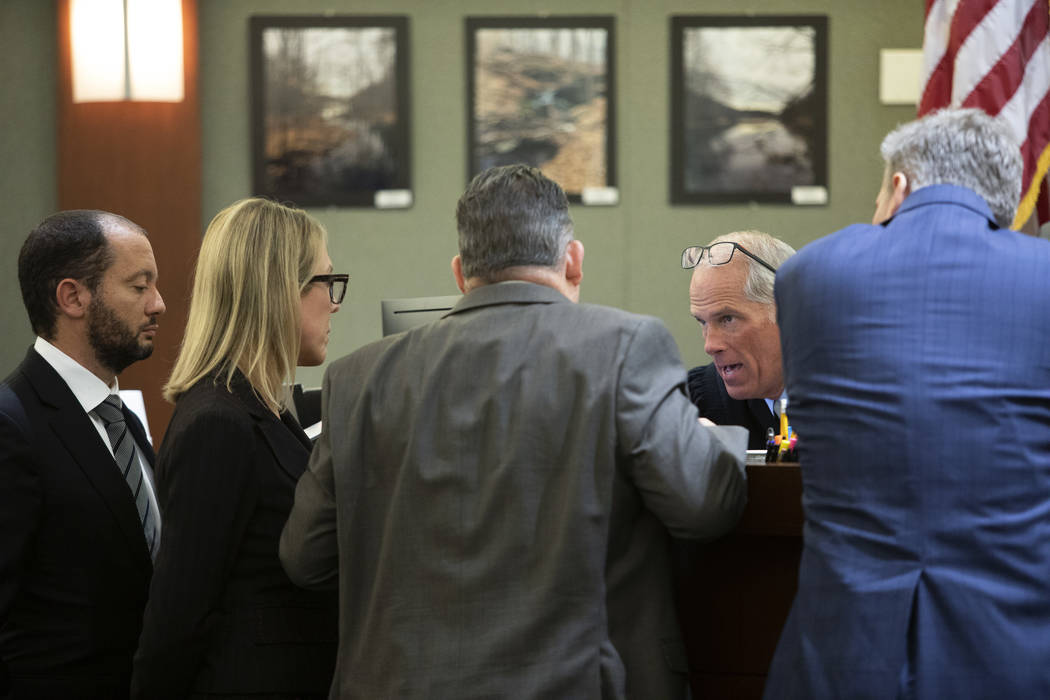 Chief Deputy District Attorneys Christopher Hamner, left, Michelle Fleck, second from left, def ...