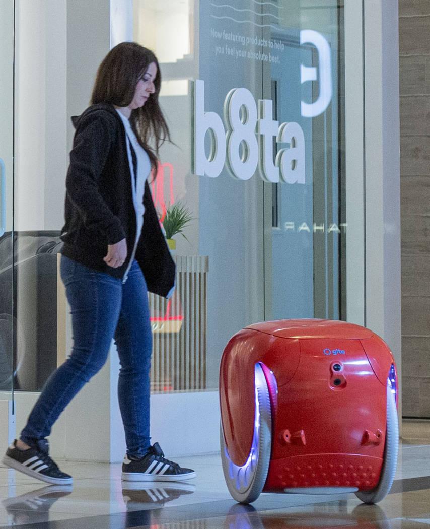 The gita robot follows b8ta store manager Laynie Shrago as she walks backward into the recently ...