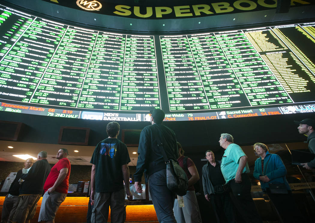 Bettors wait in line at Westgate Sportsbook as Super Bowl prop bets are listed on Thursday, Jan ...