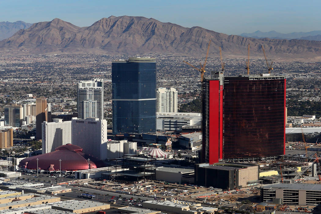 An aerial view of the Drew Las Vegas, center, and Resorts World Las Vegas, right, from the Good ...