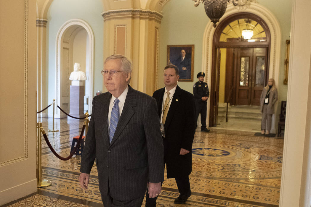 Senate Majority Leader Mitch McConnell, R-K.Y., walks to his office past the Senate chamber ent ...