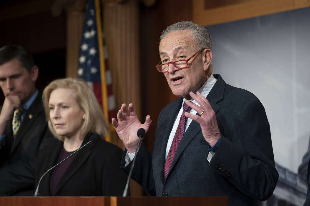 Senate Minority Leader Chuck Schumer, D-N.Y., joined from left by Sen. Martin Heinrich, D-N.M., ...