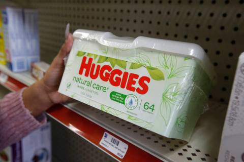 Alice White displays a package of Huggies disposable wipes at Pucci's Leader Pharmacy in Sacram ...