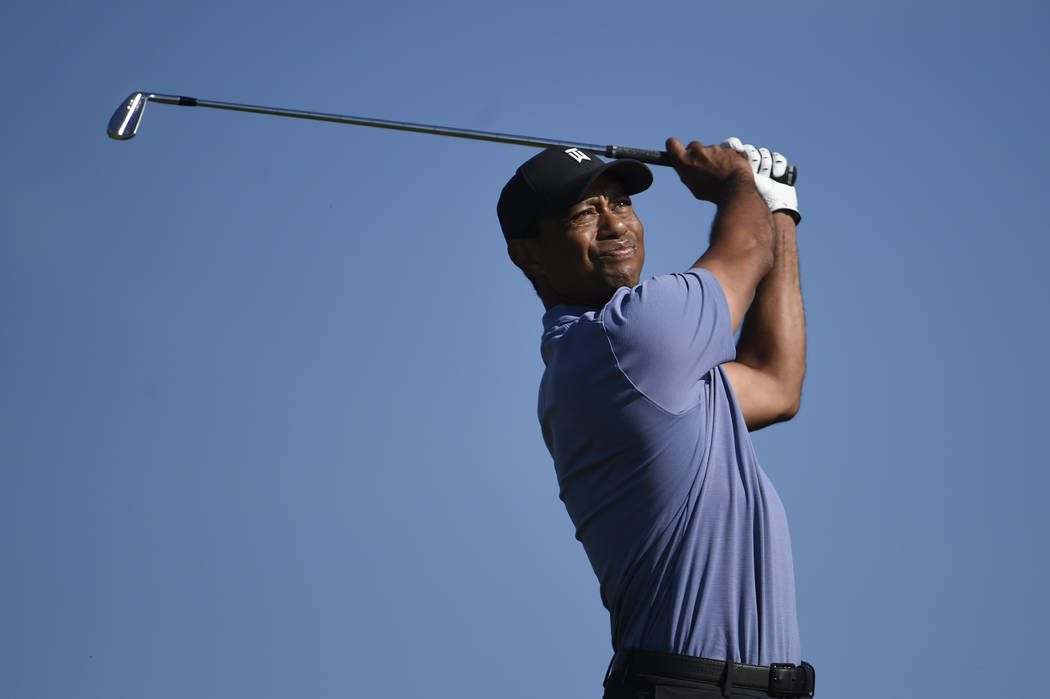 Tiger Woods hits hit tee shot on the 15th hole of the North Course at Torrey Pines Golf Course ...