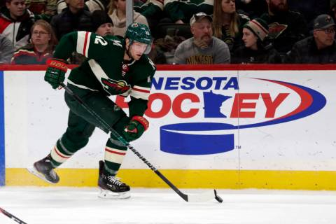 Minnesota Wild center Eric Staal controls the puck against the Calgary Flames during an NHL hoc ...