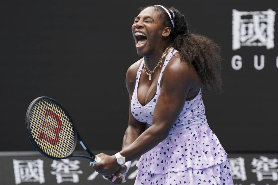 Serena Williams of the U.S. reacts as she plays China's Wang Qiang in their third round singles ...