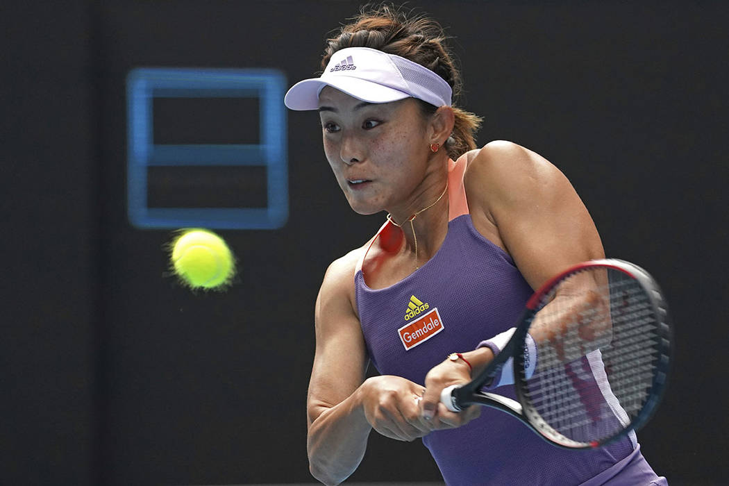 China's Wang Qiang returns a backhand to Serena Williams of the U.S. in their third round singl ...