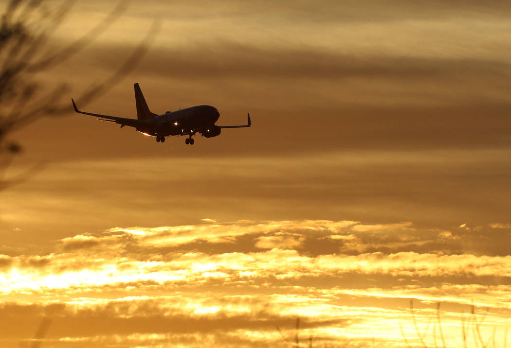 A Southwest Airlines plane approaches McCarran International Airport during sunrise on Friday, ...