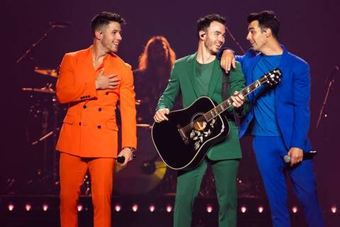 Nick Jonas, from left, Kevin Jonas, and Joe Jonas, of The Jonas Brothers, perform on stage on F ...