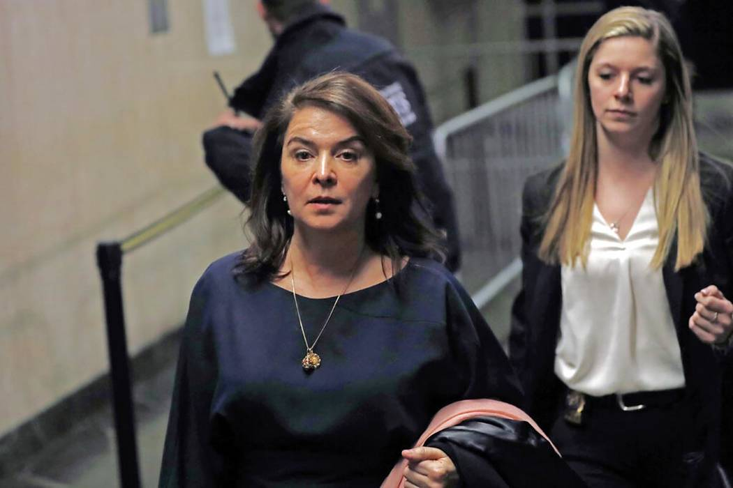 Actress Annabella Sciorra, left, leaves Manhattan Criminal Court after appearing at Harvey Wein ...