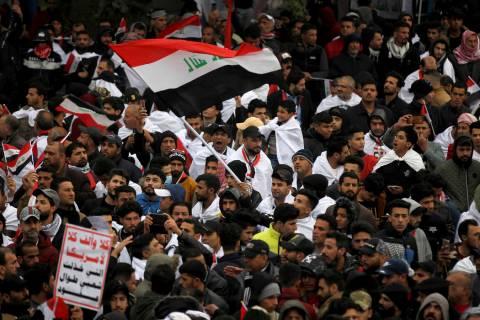 Followers of Shiite cleric Muqtada al-Sadr gather in Baghdad, Iraq, Friday, Jan. 24, 2020. Thou ...