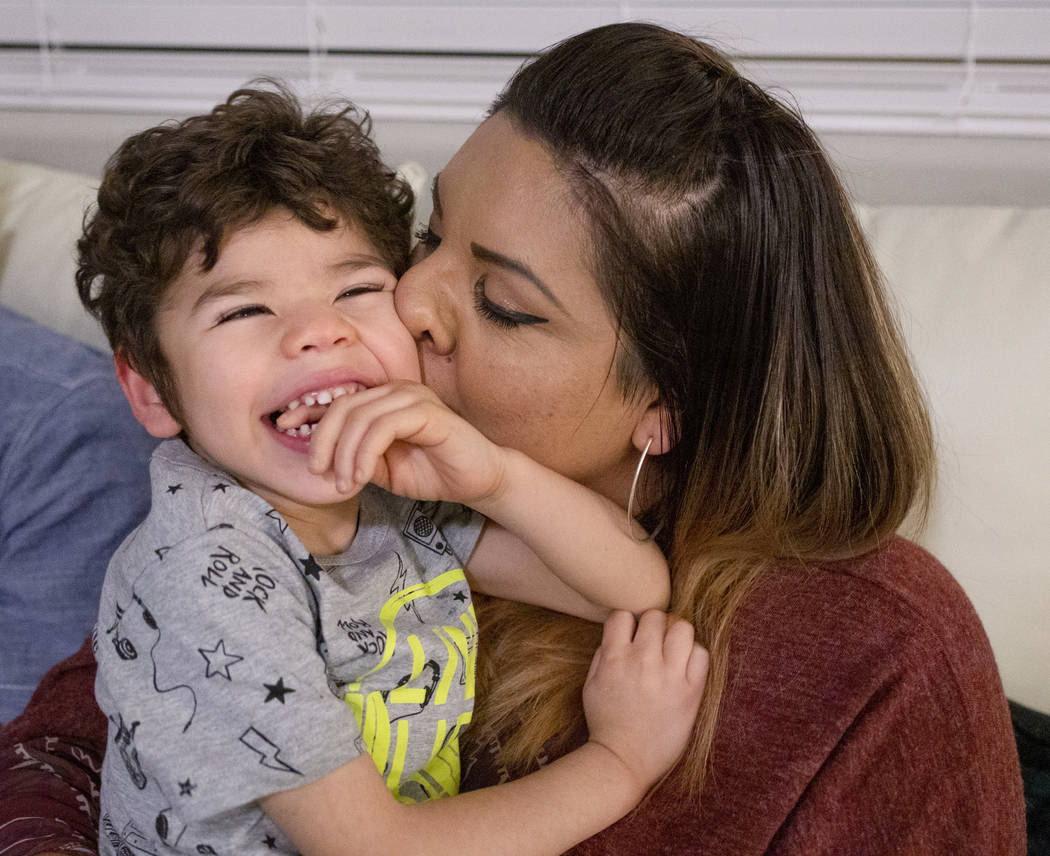 Rio Hansen, 3, is kissed by his mom Cecilia in their home in Henderson on Wednesday, Dec. 18, 2 ...