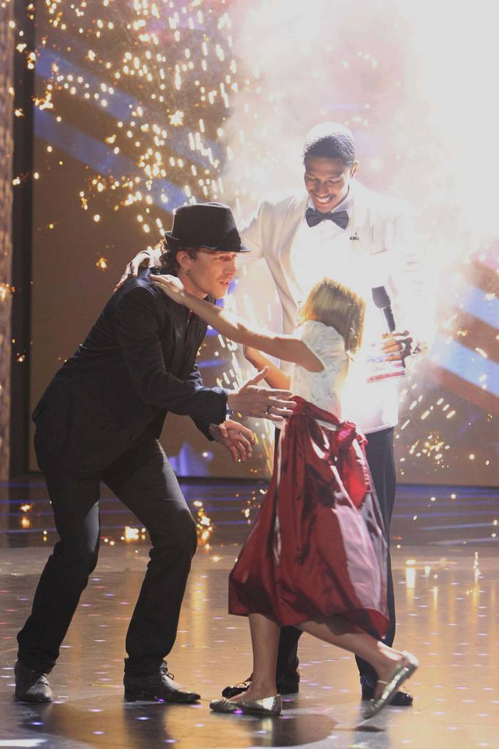 "From left, Michael Grimm, Nick Cannon and Jackie Evancho perform in ""America's Got Talent."" (Tr ..."