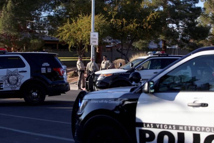 Las Vegas police investigate a shooting near Desert Pines High School in Las Vegas, Friday, Jan ...