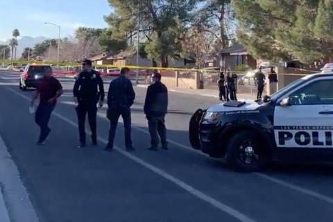 Las Vegas police investigates a shooting near Desert Pines High School in Las Vegas, Friday, Ja ...