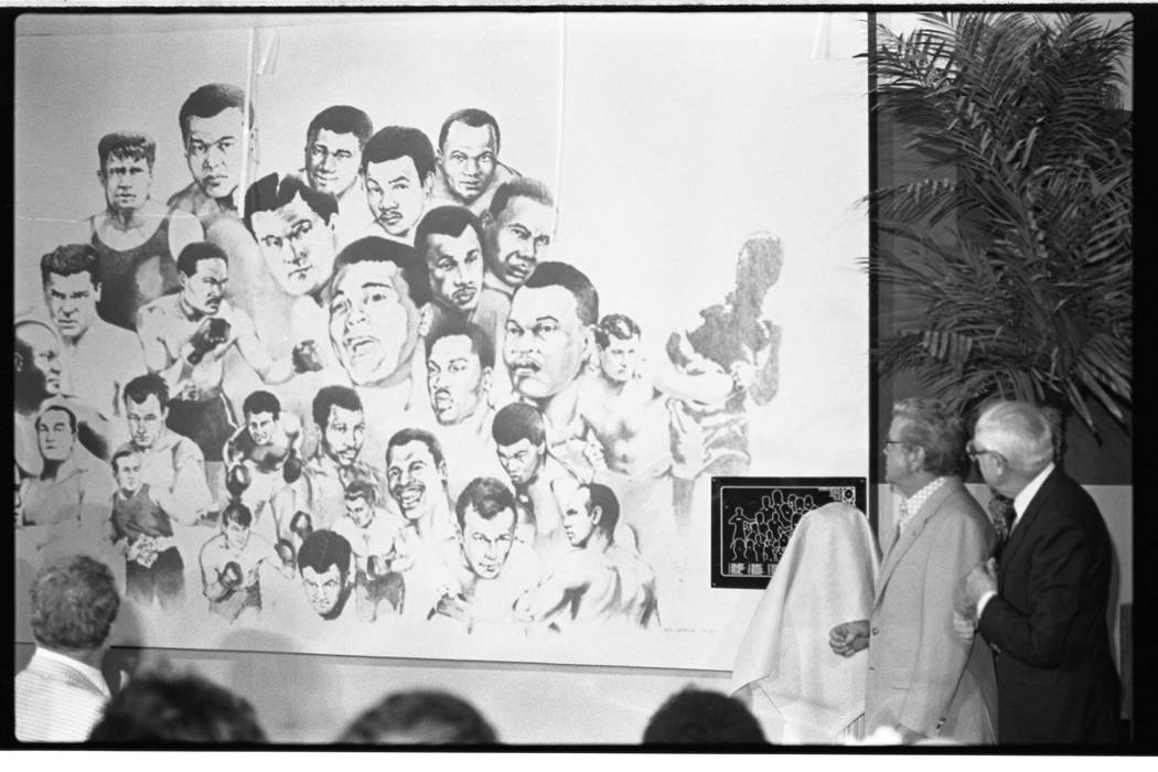 A mural is unveiled during a ceremony at the International Boxing Hall of Fame at the Dunes hot ...
