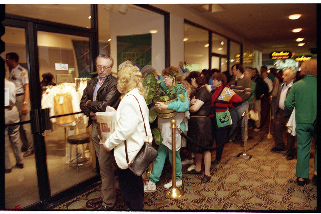 Shoppers line up to purchase Dunes towels, dishes and plants at discount prices on the hotel's ...