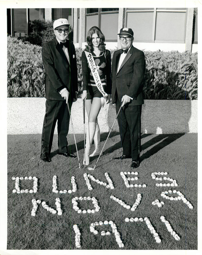 """This photo, from Nov. 9, 1971, is captioned """"Men in tuxedos and golf queen,"""" and that probably ..."""