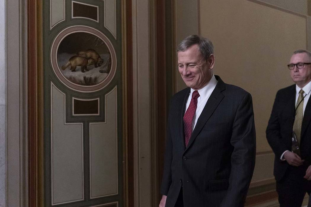 Chief Justice of the United States John Roberts departs the Capitol as the Senate finishes its ...