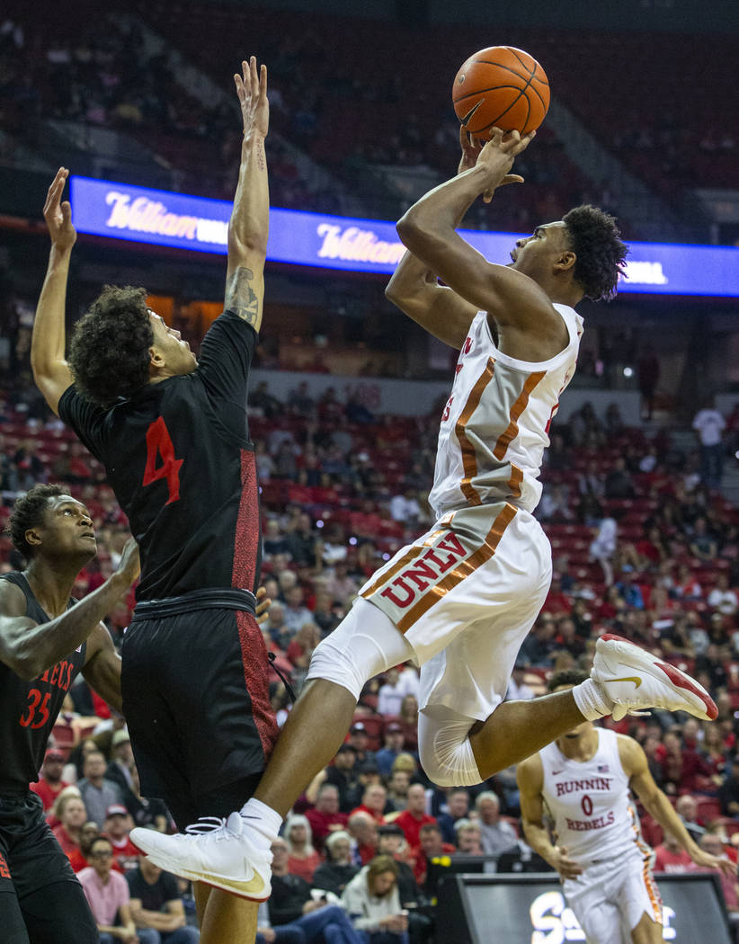 UNLV Rebels guard Bryce Hamilton (13, right) gets off a shot over San Diego State Aztecs guard ...