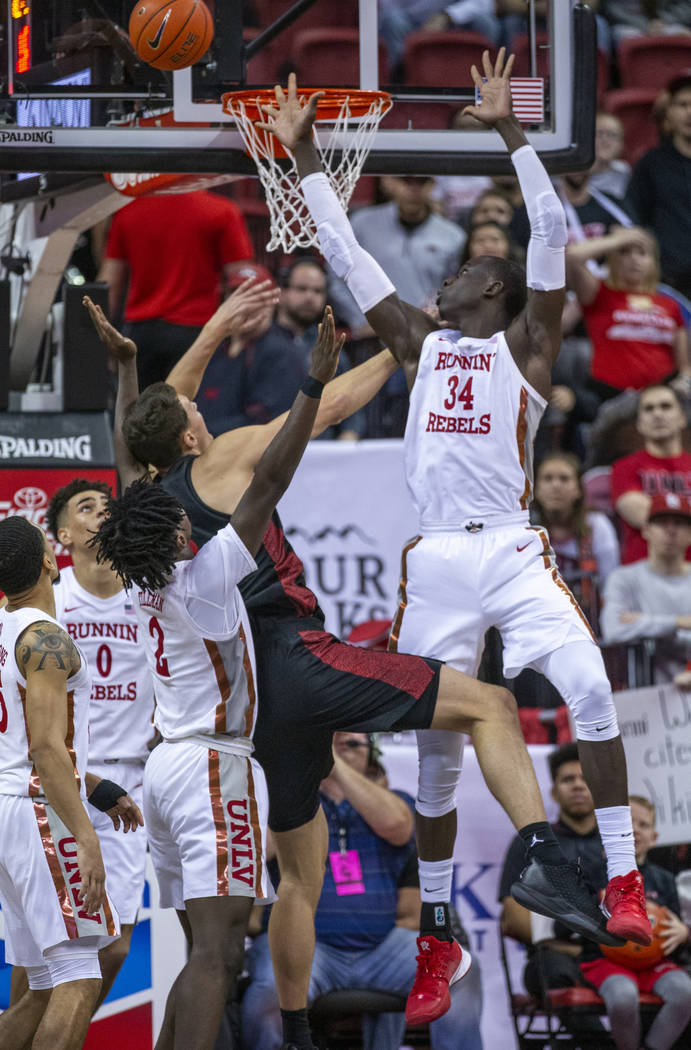 UNLV Rebels forward Cheikh Mbacke Diong (34, right) rejects a shot by San Diego State Aztecs fo ...
