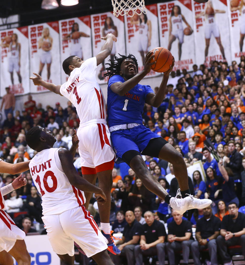 Bishop Gorman's Will McClendon (1) goes to the basket past Coronado's Jaden Hardy (1) during th ...