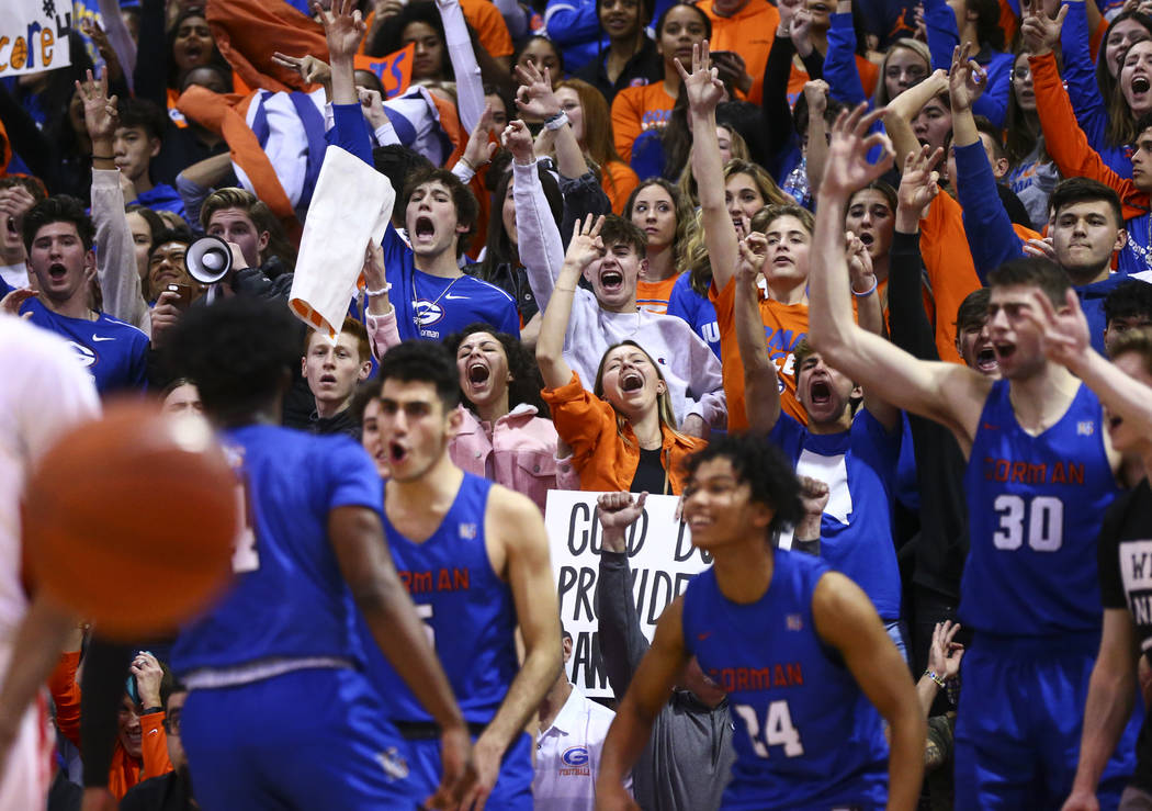 Bishop Gorman students cheer during the second half of a basketball game against Coronado at th ...