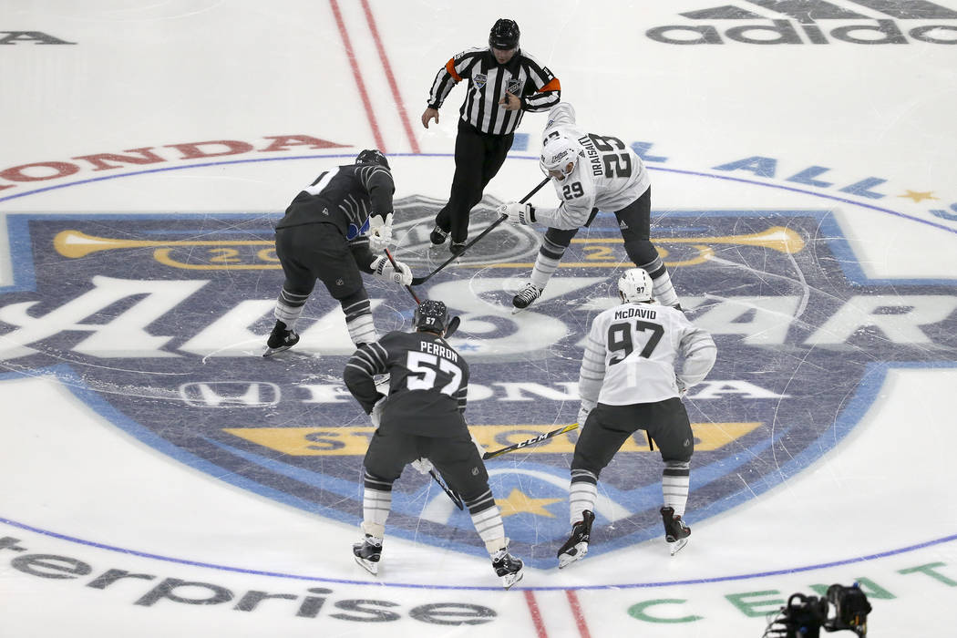 The puck is dropped for the start of the NHL All-Star hockey semifinal game between the Central ...