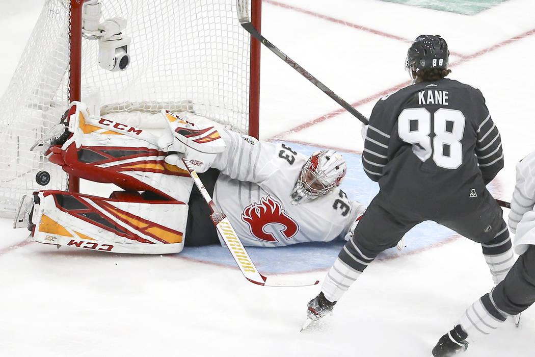 Calgary Flames goalie David Rittich (33) blocks a shot against Chicago Blackhawks forward Patri ...