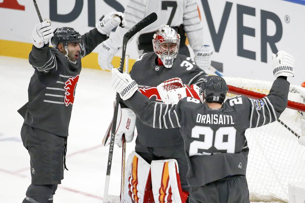 Calgary Flames goalie David Rittich (33) celebrates with Calgary Flames defender Mark Giordano, ...