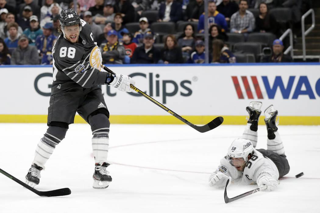 Boston Bruins forward David Pastrnak (88) scores a goal past Pittsburgh Penguins defender Kris ...