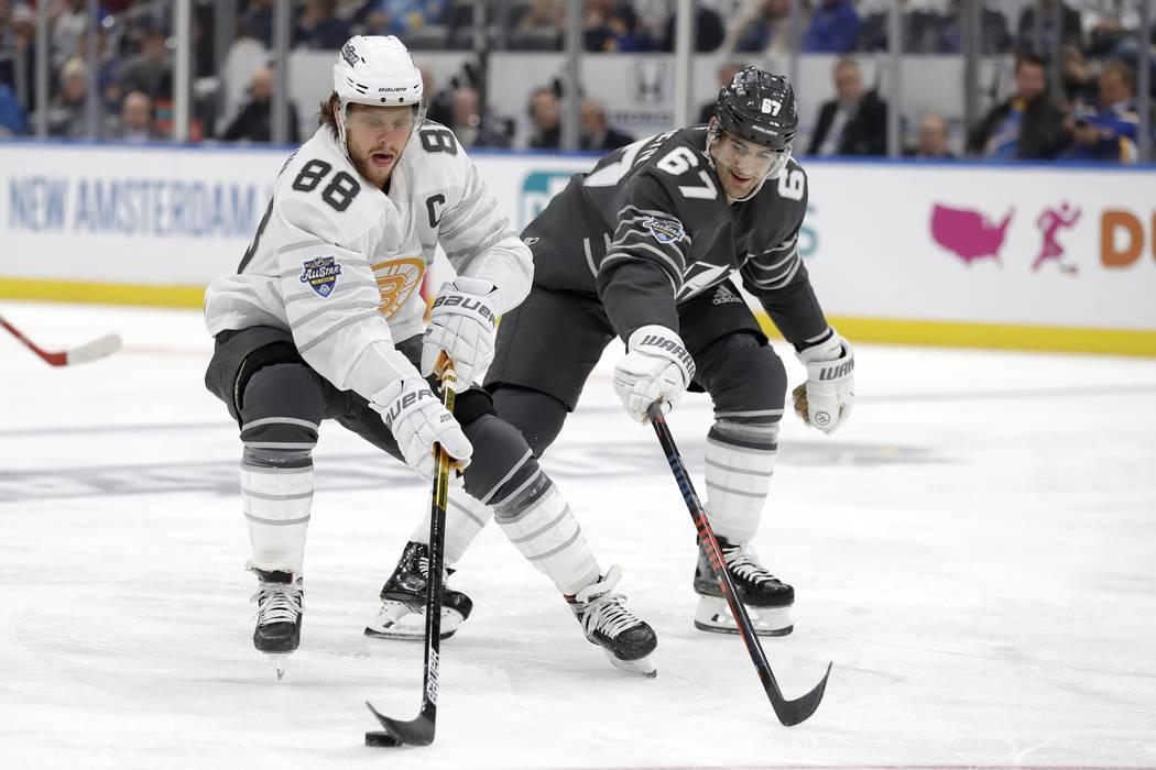 Boston Bruins forward David Pastrnak (88) moves the puck against Vegas Golden Knights forward M ...