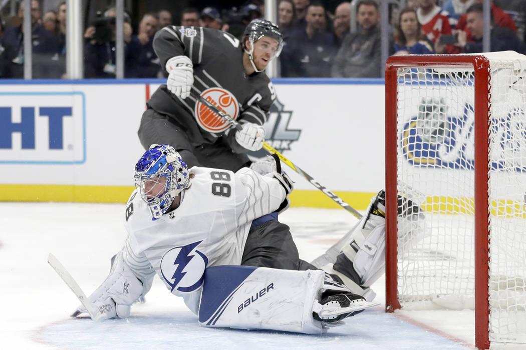 Tampa Bay Lightning goalie Andrei Vasilevskiy (88) reaches back to block a shot by Edmonton Oil ...
