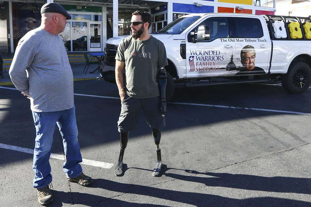 Rick Harrison, left, talks with Navy veteran and Purple Heart recipient Andrew Bottrell, who wa ...