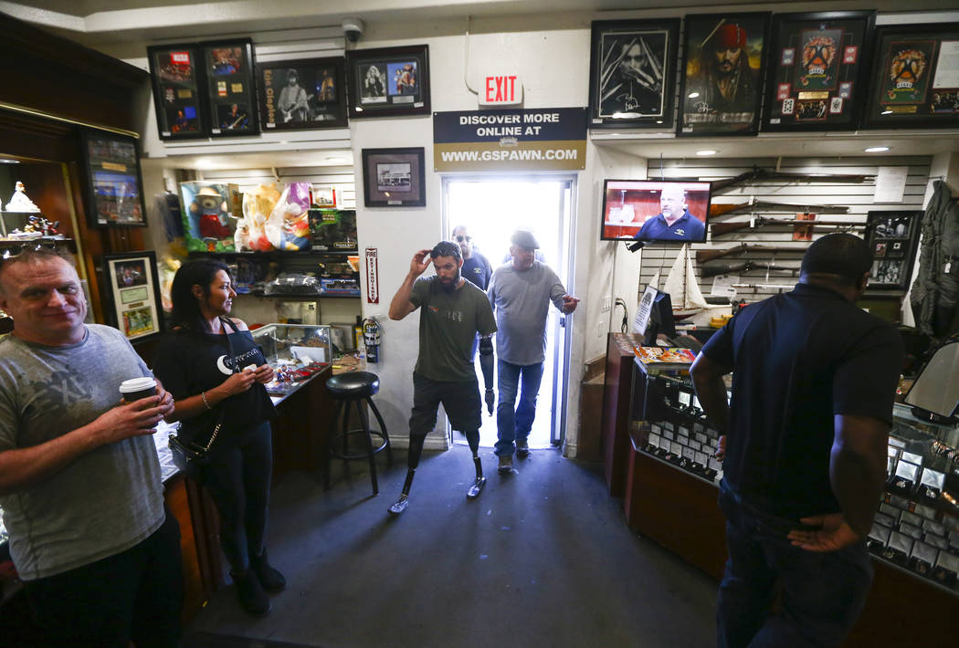 Rick Harrison, right, walks into Gold & Silver Pawn with Navy veteran and Purple Heart reci ...