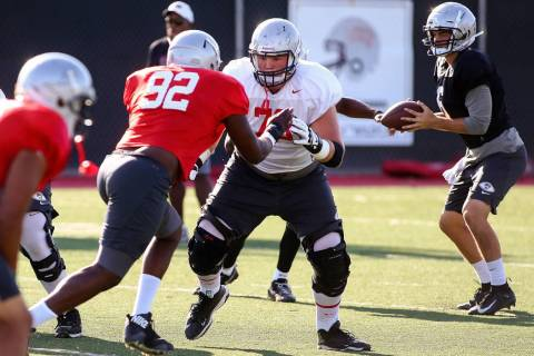 UNLV Rebels offensive lineman Ashton Morgan (73) defends against UNLV Rebels defensive lineman ...