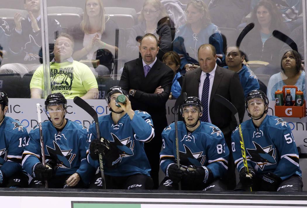 San Jose Sharks head coach Peter DeBoer watches game action alongside assistant coach Steve Spo ...