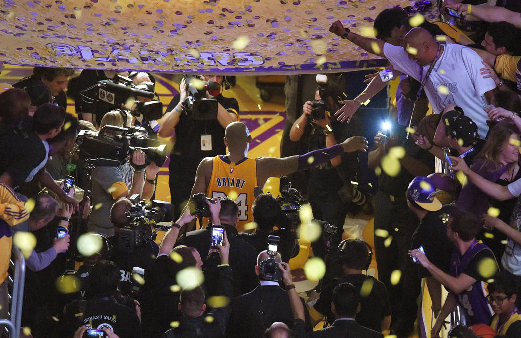 Los Angeles Lakers forward Kobe Bryant walks off the court after finishing his last NBA basketb ...