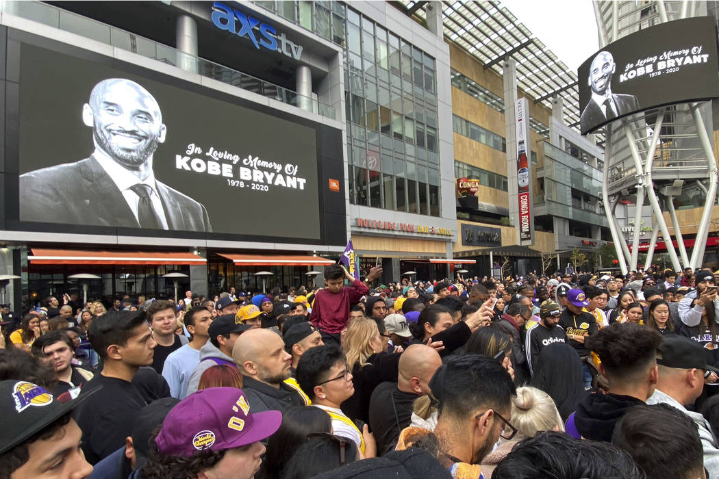 Thousands of fans mourn the loss of Kobe Bryant with makeshift memorials in front of La Live ac ...