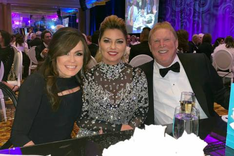 Shania Twain, center, is shown with Marie Osmond and Las Vegas Raiders owner Mark Davis at the ...