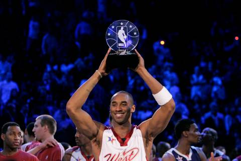 NBA Western Conference player Kobe Bryant holds up the Most Valuable Player trophy after it was ...