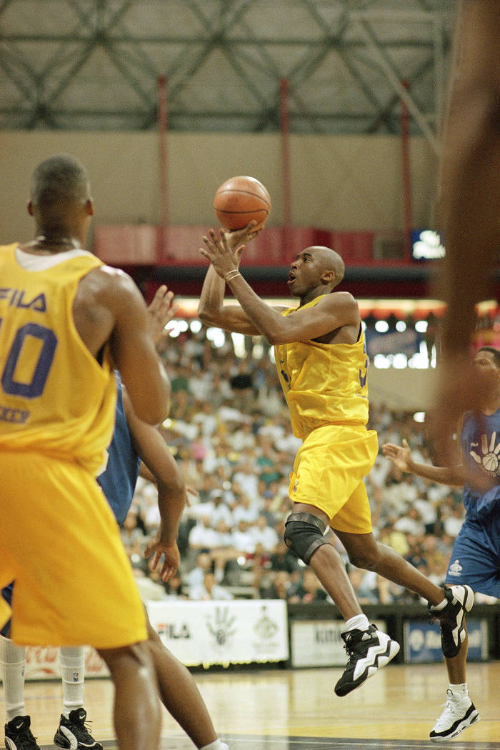 Newly-acquired Los Angeles Laker Kobe Bryant drives the open lane during a summer league game a ...